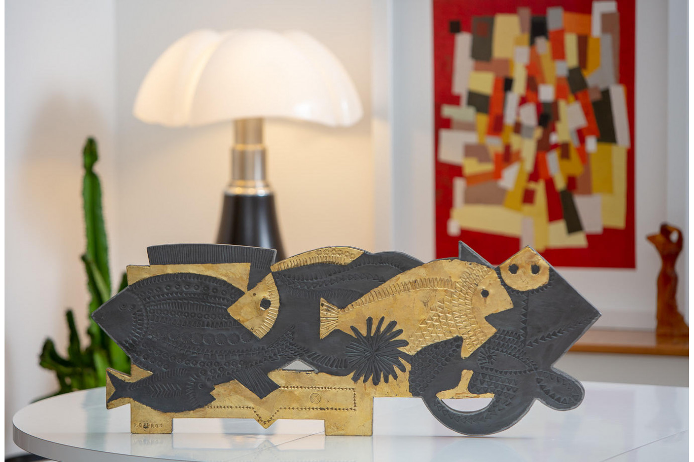 Roger CAPRON (1922-2006)  - Fish. Shiny lead partially punched with a veneer.